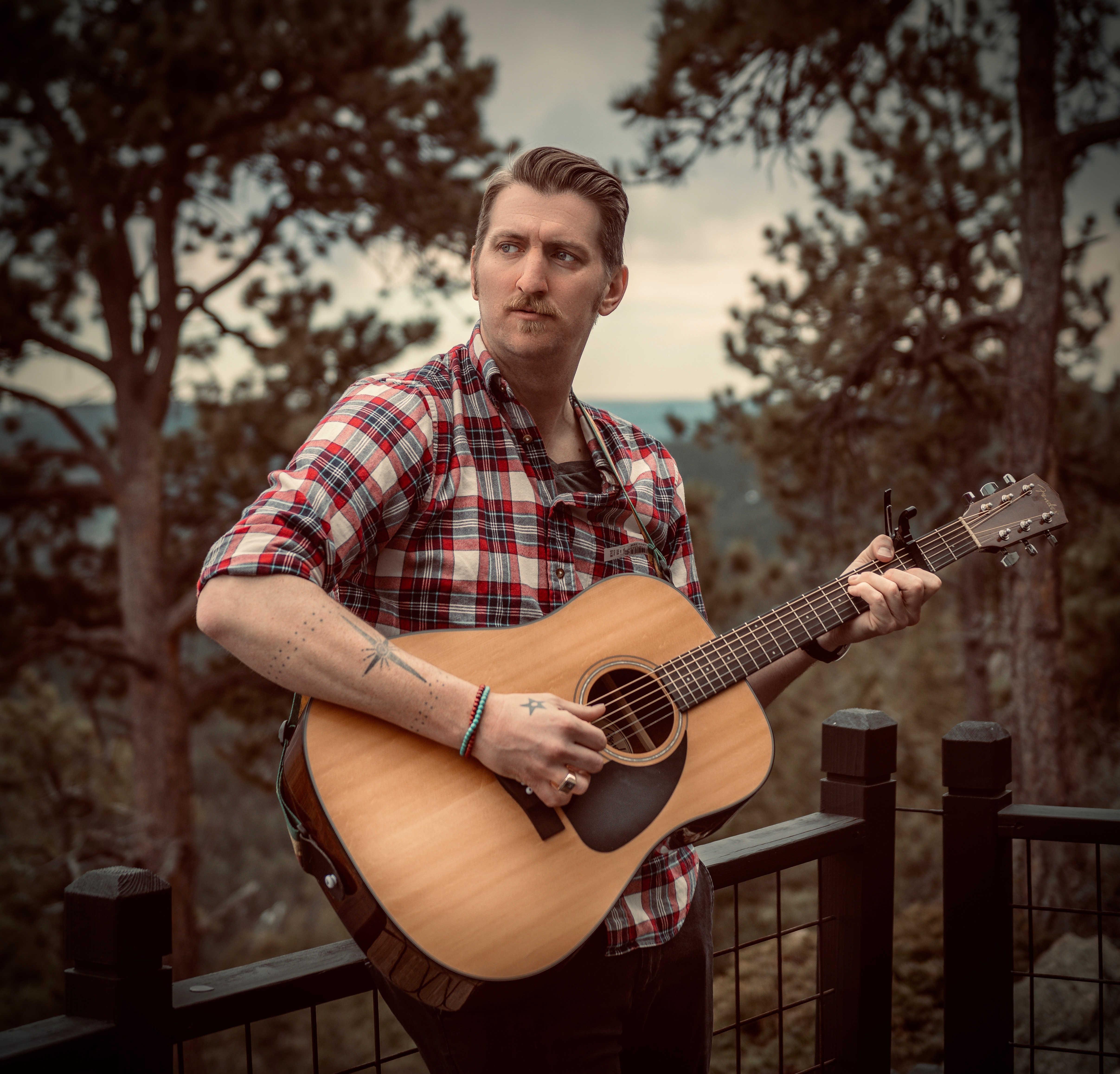 Joshua Bucy holding guitar